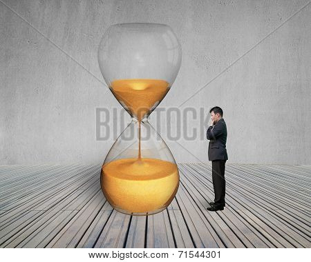 Standing Manager Looking The Hourglass