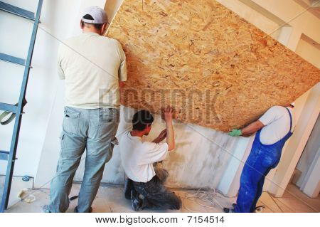Group Of Construction Workers Working