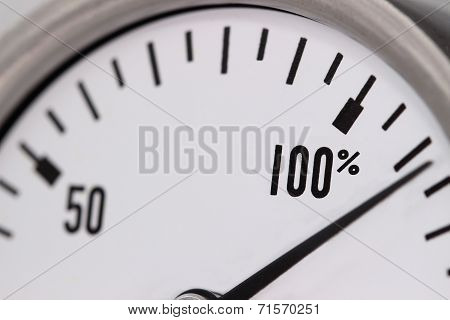 A gauge showing 110 percent and beyond. poster