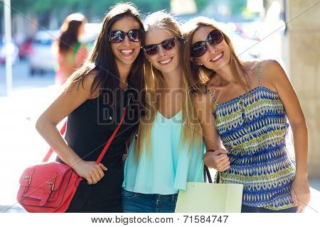 Group Of Beautiful Young Girls In The Street. Shopping Day.