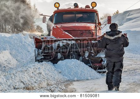 Worker controls snow cleaning process
