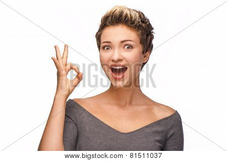 Beautiful young woman showing ok sign