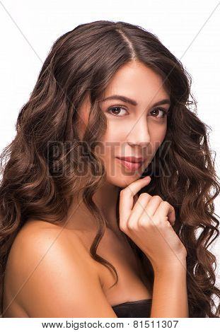 Portrait of good looking woman with curly hair