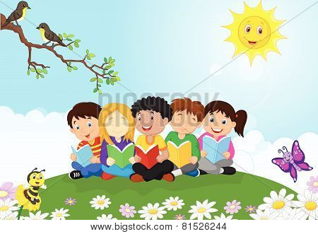 Happy children cartoon sitting on the grass while reading books