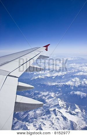 Airplane Wing Above Alps