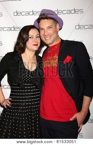 LOS ANGELES - MAR 20:  Jennifer Tilly, Cameron Silver at the Decades: Les Must De Moschino Event at Decades Boutique on March 20, 2014 in Los Angeles, CA