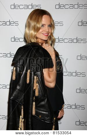 LOS ANGELES - MAR 20:  Mena Suvari at the Decades: Les Must De Moschino Event at Decades Boutique on March 20, 2014 in Los Angeles, CA