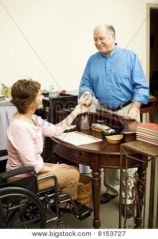 Store Clerk In Wheelchair