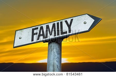 Family sign with a sunset background