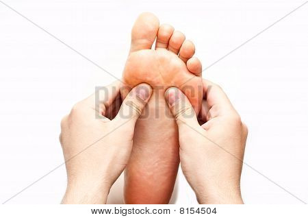 Male Hands Massaging Female Foot