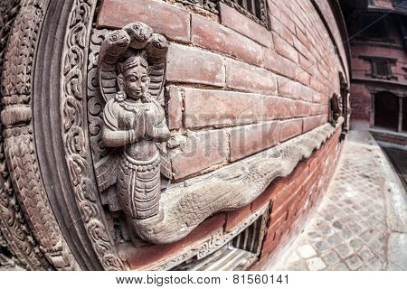Wooden carved snake Goddess at king palace museum on Durbar square in Kathmandu Nepal poster