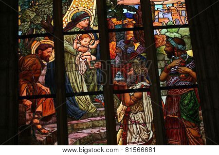 KUTNA HORA, CZECH REPUBLIC - AUGUST 23, 2014: Adoration of the Magi. Art Nouveau stained glass window in Saint Barbara Church in Kutna Hora, Czech Republic.