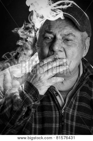Black and white portrait of old man, smoking