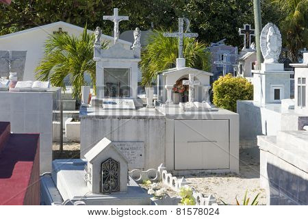 ISLA MUJERES - JANUARY 21: Local colorful cemetery in the town on 21 January 2015 in Isla Mujeres, Mexico. The cemetery is full of traditional colorful tombstones.