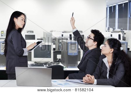 Business Manager In Meeting Room With Partners