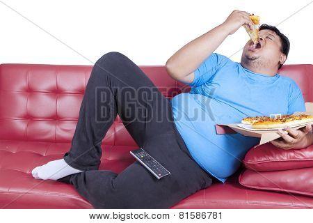 Overweight Man Eats Pizza