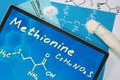 Tablet with the chemical formula of   Methionine . Amino acids. poster
