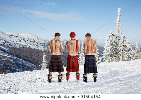 Three men peeing