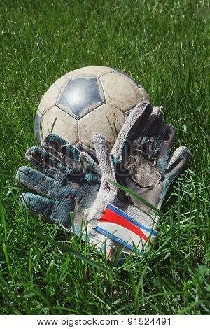 Ball and glove on the grass