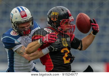 ST. POELTEN, AUSTRIA - MAY 30, 2014: RB Danny Washington (#2 Germany) is tackled by DB Pekka Rantala (#4 Finland) during the EFAF European Championships 2014 in Austria.