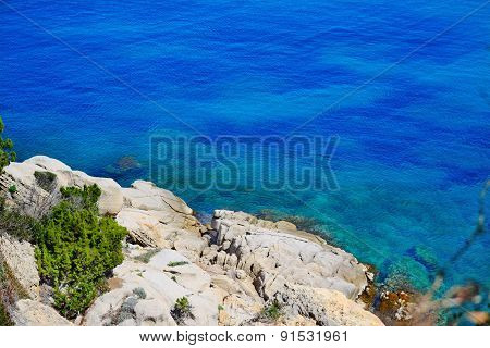 White Rocks And Blue Water In Capo Testa