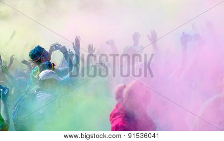 The Participants In The Color Run Waiving The Arms In The Sky