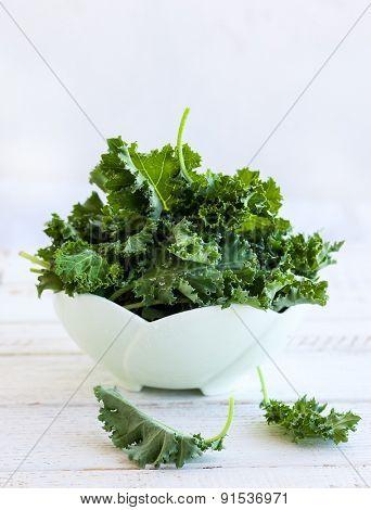 Fresh green kale leaves in  bowl