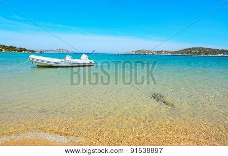 Rubber Boat Moored By The Shore In Porto Pollo