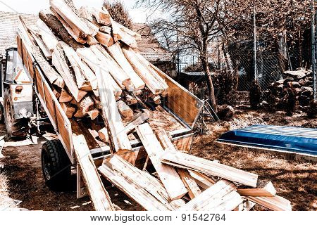logging tractor on the back yard - wood for fire