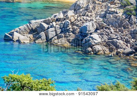 Grey Rocks And Blue Water