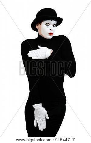 Male mime artist showing shyness. Isolated over white.