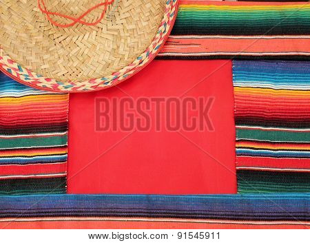 Traditional Mexican fiesta poncho rug in bright colors with sombrero background with copy space poster