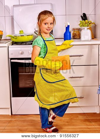 Child little girl  cleaning  home kitchen. Housekeeping.