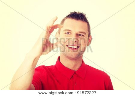 Excited man showing copy space on his hand