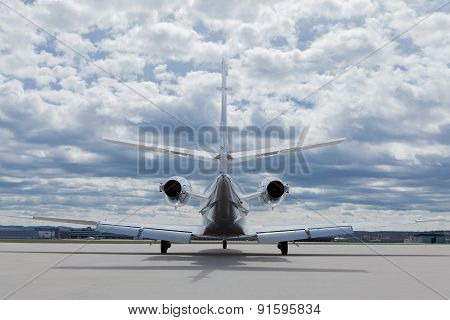 Aircraft learjet Plane in front of the Airport with cloudy sky poster