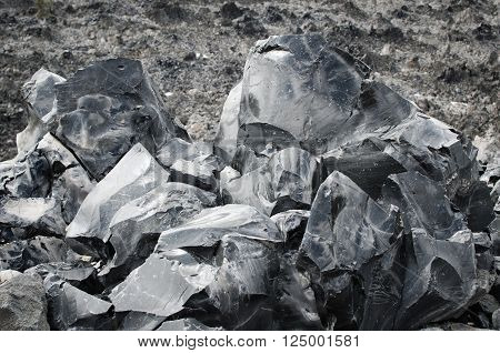 A closeup of large chunks of obisidian in the Obsidian Flow in Bend Oregon