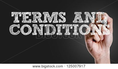 Hand writing the text: Terms and Conditions