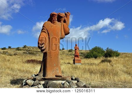 MOUNT ARAGATS,ARMENIA - OCTOBER 02:Statues creator Armenian Alphabet - Mesrop Mashtots and his disciple on Mount Aragats park of letters (Armenian Alphabet)Armenia on October 02,2011.