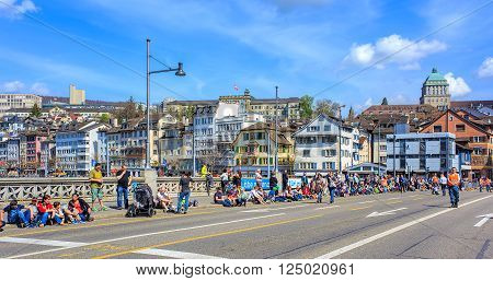 Zurich, Switzerland - 13 April, 2015: people on the Rudolf Brun bridge waiting for the Sechselauten parade to begin. The Sechselauten is a traditional spring holiday in the city of Zurich.