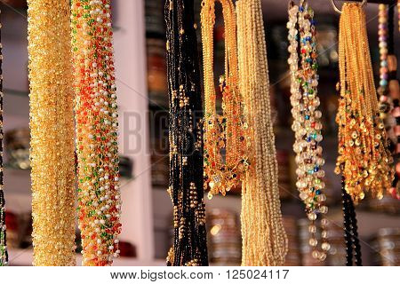 Variety of bead necklaces on display for sale at a fancy store