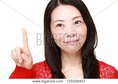 portrait of Japanese woman presenting and showing something