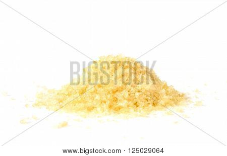 Pile of gelatin granules on white background