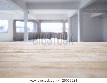 Blurred Table top counter bar with Interior Loft space background