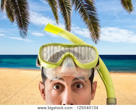 Beach vacation surprised man wearing a snorkel scuba mask making a goofy face. Closeup portrait of man on his travel holidays