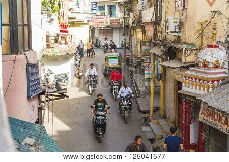 UDAIPUR INDIA - 20TH MARCH 2016: A view along streets of Udaipur in the Rajastan district of India. Lots of people and traffic can be seen.