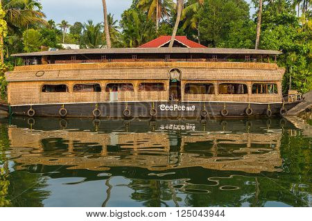 KERALA BACKWATERS INDIA - 2ND APRIL 2016: Traditional houseboats in the Kerala backwaters of south India during the day.