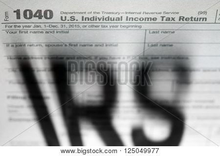 Tax forms background with IRS shadow