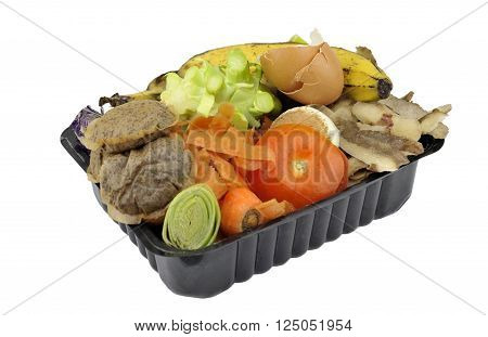 Vegetable fruit household kitchen food waste collected in re-used packaging for home composting.