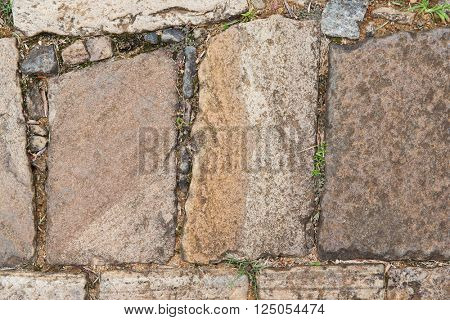 architecture, stonework and masonry concept - close up of paving stone outdoors
