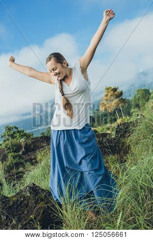 Young Woman Looking On Batur Volcano And Agung Mountain View At Morning From Kintamani, Bali, Indone